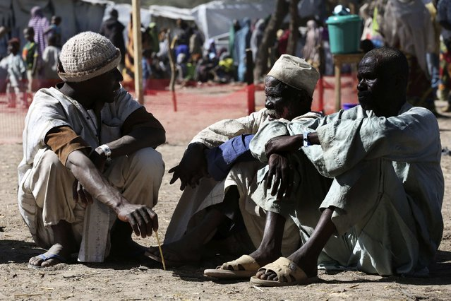 Men who have fled violence in Nigeria sit on the ground at a refugee welcoming center in Ngouboua, Chad, January 19, 2015. (Photo by Emmanuel Braun/Reuters)