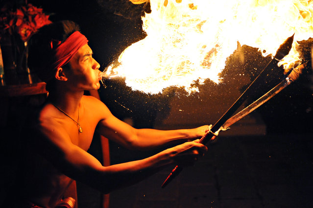 """Fire Knife Boy Chiang Mai Thailand"". While working with a Discovery Channel group in Thailand, this was part of the farewell dinner show, I wanted to get the shot, I got too close and me & all my camera gear got coated in gasoline, well worth it though! Location: Chiang Mai, Thailand. (Photo and caption by Sean Hower/National Geographic Traveler Photo Contest)"