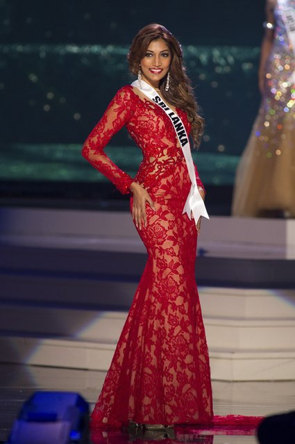 Marianne Page, Miss Sri Lanka 2014 competes on stage in her evening gown during the Miss Universe Preliminary Show in Miami, Florida in this January 21, 2015 handout photo. (Photo by Reuters/Miss Universe Organization)