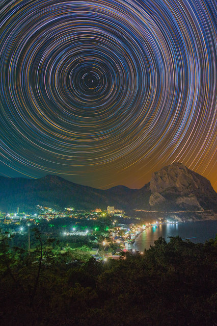Vibrate, colorful star trails over a cityscape. (Photo by Evgeniy Zaytsev/Caters News)
