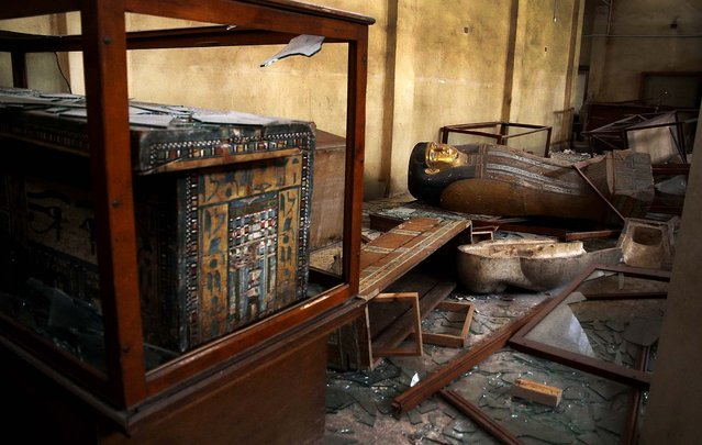 Damaged pharaonic objects lie on the floor and in broken cases in the Malawi Antiquities Museum after it was ransacked and looted in Malawi, south of Minya, Egypt, on August 17, 2013. (Photo by Roger Anis/El Shorouk Newspaper)