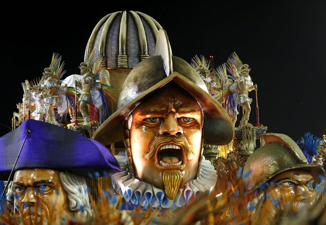 Revelers from the Beija Flor  samba school participate in the annual carnival parade in Rio de Janeiro's Sambadrome, February 17, 2015. (Photo by Pilar Olivares/Reuters)