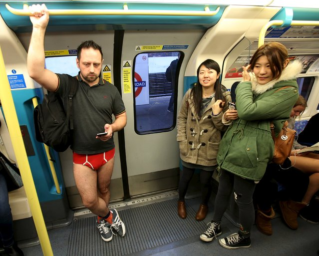 Passengers react to a participant in the annual No Trousers On The Tube Day, on the London Underground, Britain January 10, 2016. (Photo by Paul Hackett/Reuters)