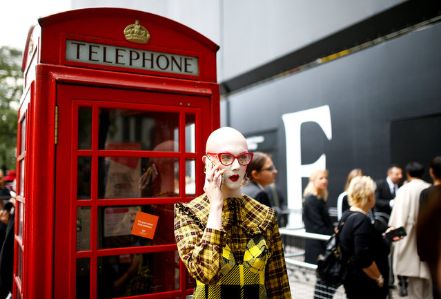 People gather outside the BFC Showspace for London Fashion Week Women's, London, Britain September 14, 2018. (Photo by Henry Nicholls/Reuters)
