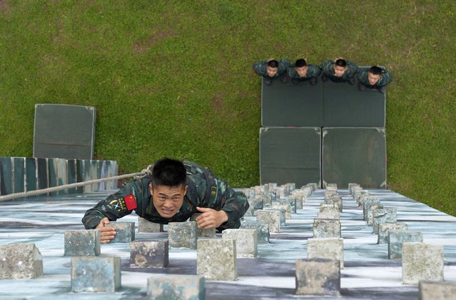 Members of the special operations team conduct a building climbing training in Qinzhou, south China's Guangxi Zhuang Autonomous Region, April 13, 2021. (Photo credit should read Costfoto/Barcroft Media via Getty Images)