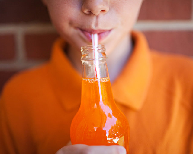 Boy drinking orange soda. (Photo by Melissa Lomax Speelman/Getty Images/Flickr RF)