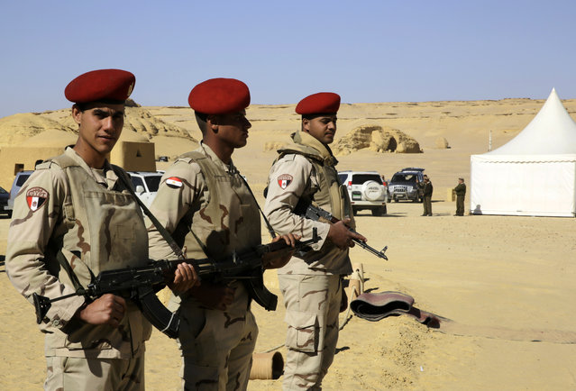 Egyptian Army soldiers stand guard outside the Wati El Hitan Fossils and Climate Change Museum, a UNESCO natural World Heritage site, on the opening day, in the Fayoum oasis, Egypt, Thursday, January 14, 2016. (Photo by Thomas Hartwell/AP Photo)