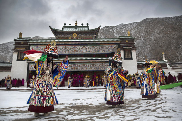 Tibetan Buddhist monks perform a black hat dance during Monlam or the Great Prayer rituals on March 4, 2015 at the Labrang Monastery, Xiahe County, Amdo, Tibetan Autonomous Prefecture, Gansu Province, China. (Photo by Kevin Frayer/Getty Images)