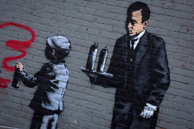 An installation by Banksy is seen in the Bronx. Known for his anti-authoritarian black-and-white stenciled images, which have sold at auction for upwards of $2 million, Banksy is treating New Yorkers to a daily dose of spray-painted art – while eluding the police and incurring the wrath of New York Mayor Michael Bloomberg. (Photo by Eric Thayer/Reuters)