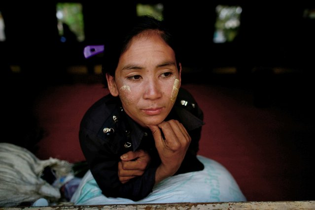 A refugee looks on in temporary refugee camp at a monastery in Lashio February 19, 2015. (Photo by Soe Zeya Tun/Reuters)