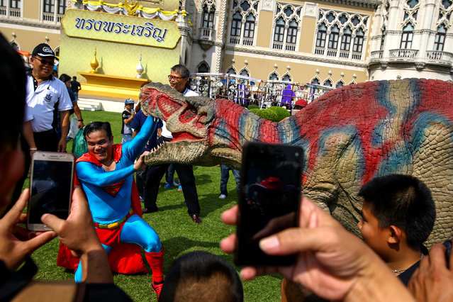 A man wearing a Superman costume and a man in a dinosaur costume perform during the Children's Day celebration at Government House in Bangkok, Thailand, January 14, 2017. (Photo by Athit Perawongmetha/Reuters)