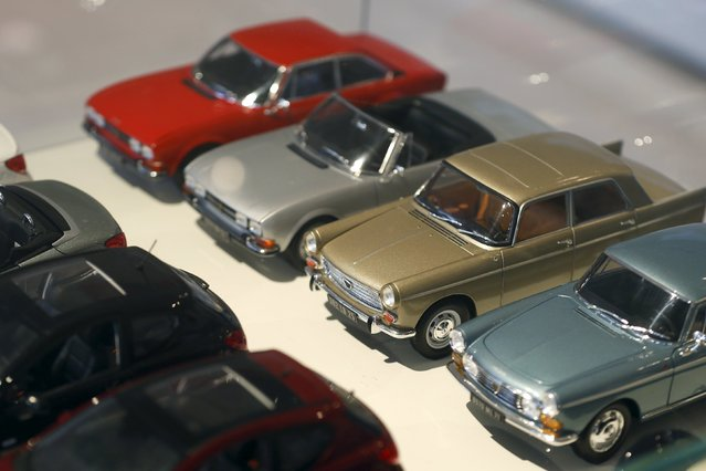Peugeot miniature model vintage cars are lined-up in the store at French carmaker PSA Peugeot Citroen headquarters in Paris in this February 13, 2013 file photo. PSA Peugeot Citroen is expected to report full-year results this week. (Photo by Charles Platiau/Reuters)