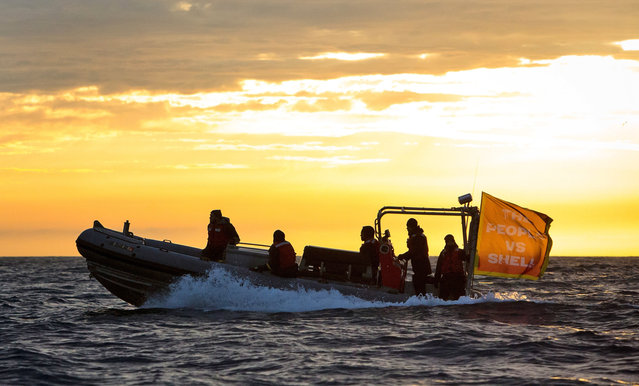 A small boat carrying protesters heads out at dawn to meet an oil drilling rig on its arrival Friday, April 17, 2015, in Port Angeles, Wash. (Photo by Daniella Beccaria/Seattlepi.com via AP Photo)