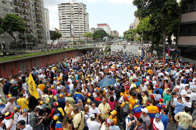 Opposition supporters takes part in a rally against Venezuelan President Nicolas Maduro's government and to commemorate the 59th anniversary of the end of the dictatorship of Marcos Perez Jimenez in Caracas, Venezuela January 23, 2017. (Photo by Christian Veron/Reuters)