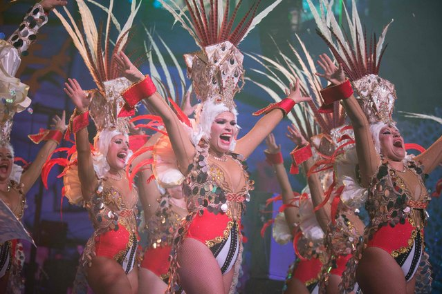 Dancers perform on the main stage in the Battle of the Troops contest during carnival celebrations in Santa Cruz de Tenerife, on the Spanish Canary island of Tenerife, on February 23, 2019. The over month-long event began on February 1st and finishes on March 10th with orchestras playing Caribbean and Brazilian rhythms throughout the festivities that range from the election of the Carnival Queen, the Junior Queen and the Senior Queen, children and adult murgas (satirical street bands), comparsas (dance groups) to performances on the streets. (Photo by Desiree Martin/AFP Photo)