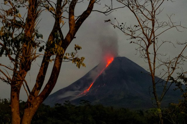 Lava flows from Mount Merapi, Indonesia's most active volcano, as seen from Tunggularum village in Sleman, Yogyakarta, on August 20, 2021. (Photo by Agung Supriyanto/AFP Photo)