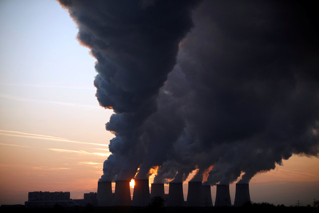 Steam billows from the cooling towers of Vattenfall's Jaenschwalde brown coal power station near Cottbus, Germany, December 2, 2009. (Photo by Pawel Kopczynski/Reuters)