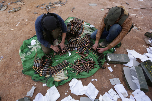 Rebel fighters arrange shells on the outskirts of the northern Syrian town of al-Bab, Syria January 26, 2017. (Photo by Khalil Ashawi/Reuters)