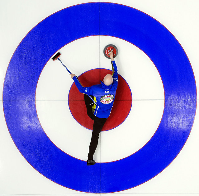 Team Alberta skip Kevin Koe makes a shot during the 10th draw against team British Columbia at the Brier curling tournament in Brandon, Manitoba, Tuesday, March, 5, 2019. (Photo by Jonathan Hayward/The Canadian Press via AP Photo)