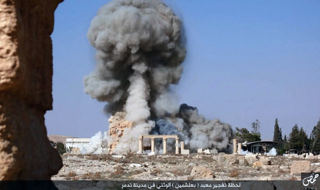This undated photo released Tuesday, August 25, 2015, file photo, on a social media site used by Islamic State militants, which has been verified and is consistent with other AP reporting, shows smoke from the detonation of the 2,000-year-old temple of Baalshamin in Syria's ancient caravan city of Palmyra. (Photo by Islamic State social media account via AP Photo)