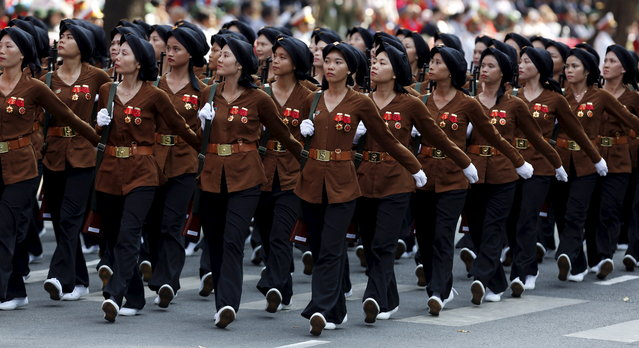 Female members of the Northern Guerilla Force march during a military parade as part of the 40th anniversary of the fall of Saigon in Ho Chi Minh City, April 30, 2015. (Photo by Reuters/Kham)