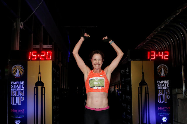 """Suzy Walsham of Australia celebrates at the finish line on the 86th floor observation deck after running up the 86 flights, 1,576 stairs of the Empire State Building to win the women's division of the 2017 """"Empire State Building Run-up"""" running race in New York, February 1, 2017. (Photo by Mike Segar/Reuters)"""