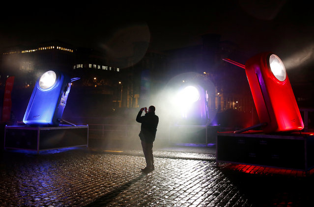 A man takes pictures of giant flashlights displayed along the Brussels' canal district during the Bright Brussels Festival in Brussels, Belgium February 4, 2017. (Photo by Francois Lenoir/Reuters)