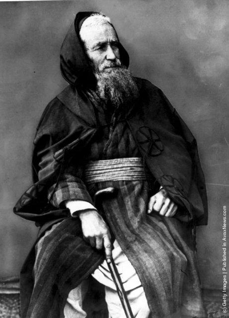 circa 1890:  A middle-class Jew from Tangiers in traditional cloak and cummerbund