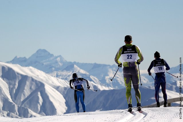 Skiers compete in the Cross Country Men's 10km Mass Start during day one of the Winter Games NZ at Snow Farm