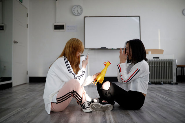 """Japanese Yuho Wakamatsu, 15, who wants to become a K-pop star, takes photographs of Japanese Yuuka Hasumi, 17, during a training session in Seoul, South Korea, March 12, 2019. Hasumi put high school in Japan on hold and flew to South Korea in February to try her chances at becoming a K-pop star, even if that means long hours of vocal and dance training, no privacy, no boyfriend, and even no phone. """"It is tough"""", Hasumi said. """"Going through a strict training and taking my skill to a higher level to a perfect stage, I think that's when it is good to make a debut"""". (Photo by Kim Hong-Ji/Reuters)"""