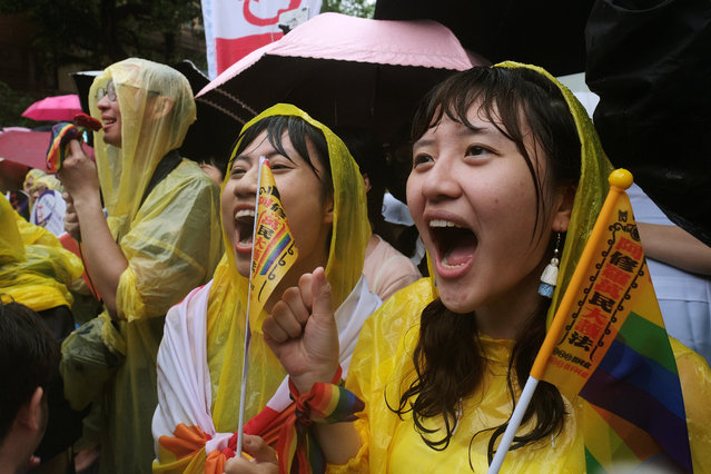 Same-s*x marriage supporters shout during a parliament vote on three draft bills of a same-s*x marriage law, outside the Legislative Yuan in Taipei, Taiwan on May 17, 2019. (Photo by Tyrone Siu/Reuters)