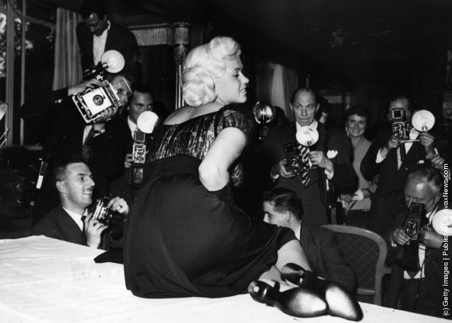 American film star, Jayne Mansfield, posing for photographers at the Dorchester Hotel, London, 1957