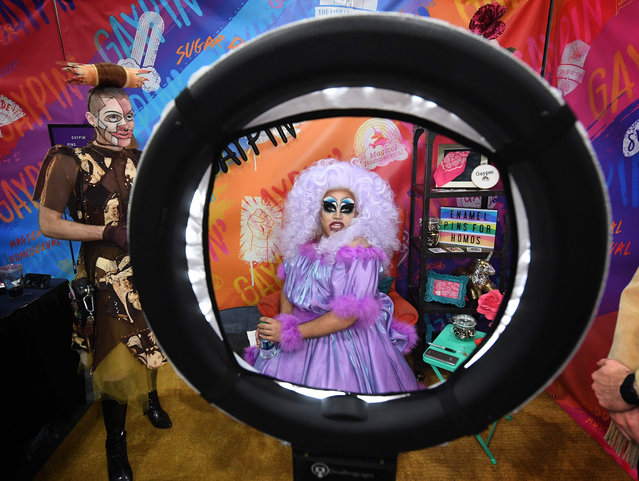 "Drag Queen Gaypin (R) and her friends attend the three day RuPaul's DragCon, which is billed as the ""first convention celebrating drag, queer culture, & self-expression"" at the Convention Center in Los Angeles, California on May 25, 2019. (Photo by Mark Ralston/AFP Photo)"