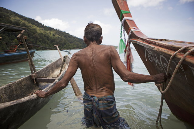 An indigenous Moken man takes his boat out from the beach near his village in Ko Surin National Park. October 11, 2013 – Ko Surin, Thailand. (Photo by Taylor Weidman/zReportage via ZUMA Press)