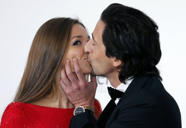 Actor Adrien Brody (R) kisses his partner Lara Lieto as they pose during a photocall at the amfAR's Cinema Against AIDS 2015 event during the 68th Cannes Film Festival in Antibes, near Cannes, southern France, May 21, 2015. (Photo by Regis Duvignau/Reuters)