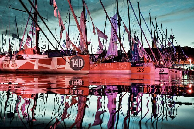 Race boats are docked on October 31, 2018 in the harbour of Saint- Malo, Brittany, few days ahead of the start of the 40 th Route du Rhum solo sailing race. Created in 1978, the Route du Rhum, a solo race held every four years between Saint- Malo to Pointe- a-Pitre, in the French West Indies, celebrates its 40 th anniversary in 2018. (Photo by Fred Tanneau/AFP Photo)
