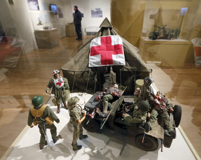 In this January 31, 2014 photo shows G.I. Joe action figures are arranged in a mobile army surgical hospital in a display at the New York State Military Museum  in Saratoga Springs, N.Y. (Photo by Mike Groll/AP Photo)
