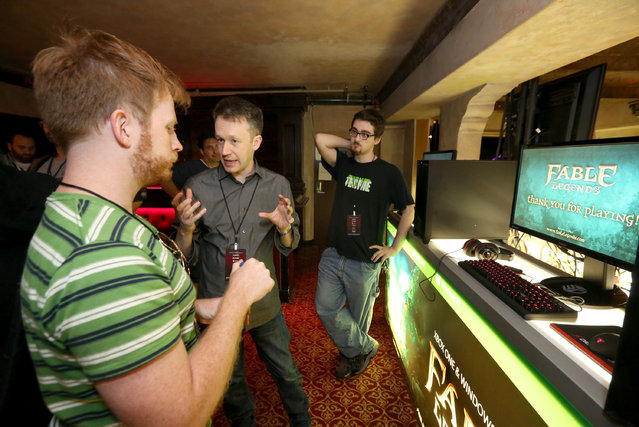 David Eckelberry, Game Director, Lionhead Studios, left, discusses Fable Legends on Windows 10 at the Xbox-sponsored PC Gaming Show at E3 in Los Angeles on Tuesday, June 16, 2015. (Photo by Casey Rodgers/Invision for Microsoft/AP Images)