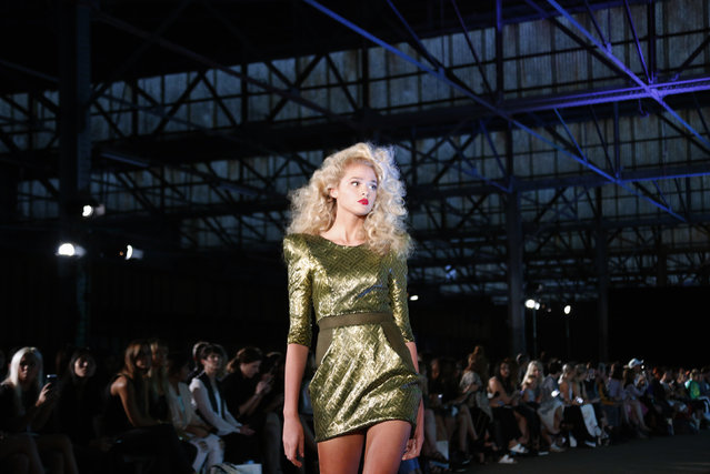 """A model presents a creation by Australian fashion label """"Zhivago"""" during a show held in an old train shed at Australian Fashion Week in Sydney April 10, 2014. The five-day fashion event showcases designs by local and international fashion labels. (Photo by David Gray/Reuters)"""