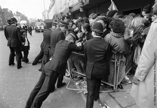 Police controlling a crowd of Michael Jackson fans outside Madame Tussauds wax museum, London, 3rd March 1985