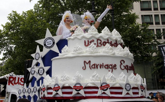 People participate dressed as a married couple in the annual Christopher Street Day parade on Kurfuerstendamm in Berlin, Germany, June 27, 2015. (Photo by Fabrizio Bensch/Reuters)