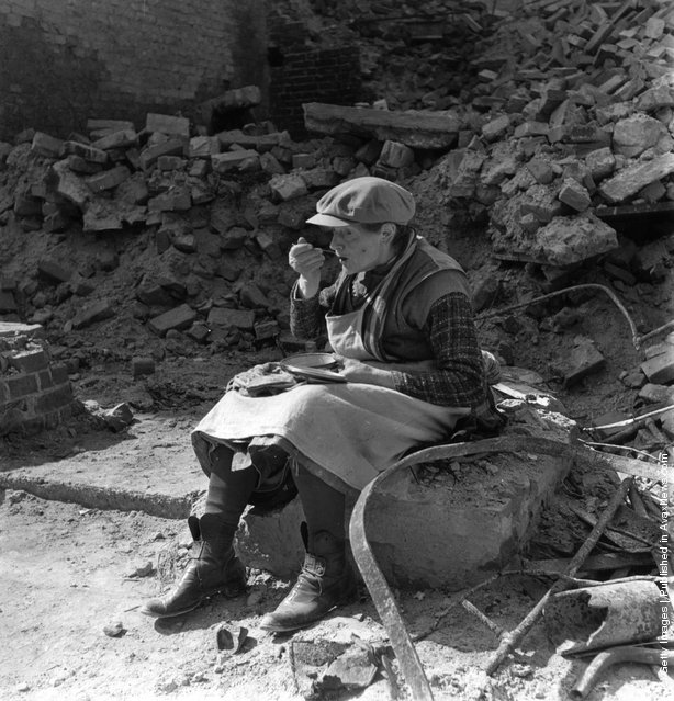 1946: An old woman eating her lunch in the rubble of Berlin
