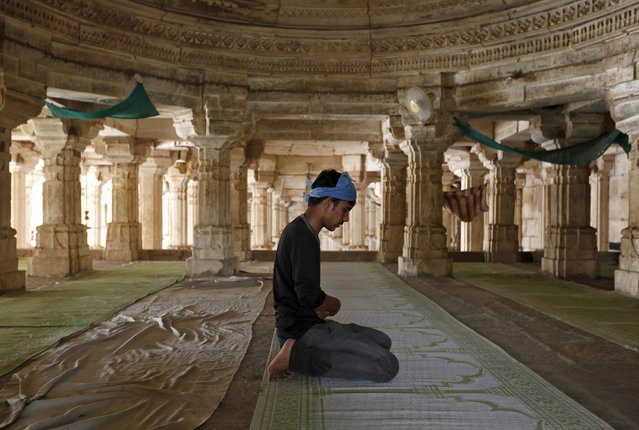 A Muslim man offers prayers on the first day of the holy month of Ramadan at a mosque in Ahmedabad, India, June 19, 2015. (Photo by Amit Dave/Reuters)