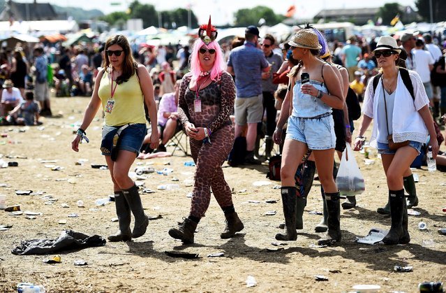 Revellers stroll in front of the Other stage at Worthy Farm in Somerset during the Glastonbury Festival in Britain, June 27, 2015. (Photo by Dylan Martinez/Reuters)