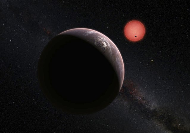 This artist's impression shows an imagined view of the three planets orbiting an ultracool dwarf star just 40 light-years from Earth that were discovered using a specialist telescope at ESO's La Silla Observatoryin Chile, according to new findings by an international team of astronomers, May 2, 2016. (Photo by M. Kornmesser/N. Risinger/Reuters/ESO)