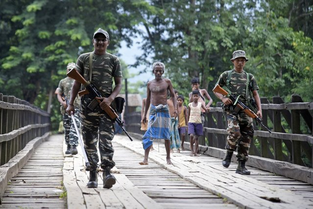 Indian security personnel patrol on a road ahead of the publication of the final draft of the National Register of Citizens (NRC) at Kachari Para village, in Hojai district, Assam, August 30, 2019. (Photo by Anuwar Hazarika/Reuters)