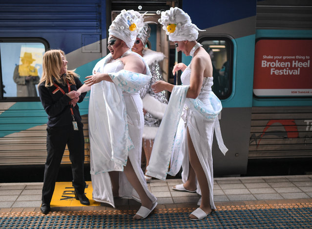 "Drag queens Maude Boate, Anita Wiglit and Kita Mean pose for a photograph before boarding the NSW TrainLink Silver City Stiletto train at Central station in Sydney, Australia, 12 September 2019. Drag queens and kings will travel to the outback NSW town of Broken Hill to attend the annual Broken Heel festival, paying homage to the iconic Australian film ""Priscilla, Queen of the Desert"". (Photo by James Gourley/AAP)"
