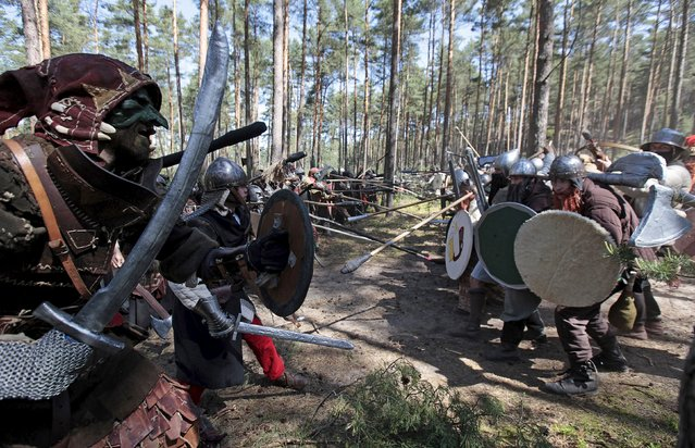 """Participants re-enact the """"Battle of Five Armies"""" from J.R.R. Tolkien's novel """"The Hobbit"""" in a forest near the town of Doksy, Czech Republic June 6, 2015. (Photo by David W. Cerny/Reuters)"""