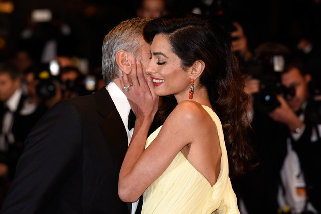"""Actor George Clooney and his wife Amal Clooney attend the """"Money Monster"""" premiere during the 69th annual Cannes Film Festival at the Palais des Festivals on May 12, 2016 in Cannes, France. (Photo by Clemens Bilan/Getty Images)"""