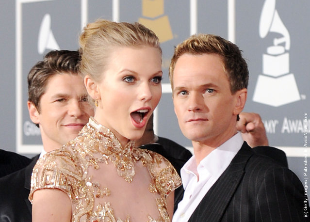 Singer Taylor Swift (L) and actor Neil Patrick Harris arrive at the 54th Annual GRAMMY Awards held at Staples Center